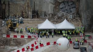 Workers gather near the breakthrough point of the world's first variable density tunnel boring machine (TBM) in Kuala Lumpur