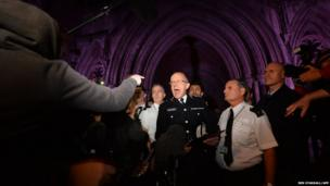 A man points and shouts at Assistant Commissioner Mark Rowley as he addresses the media and members of the public outside the Royal Courts of Justice
