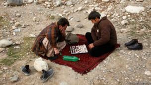 Afghans play chess in Kabul
