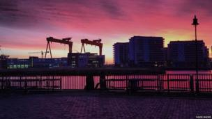 David Mackie photographed the sun rising over Belfast, with the Harland and Wolf cranes in the background.