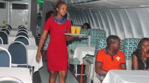 A waitress in La Tante DC 10 Restaurant, Accra, Ghana