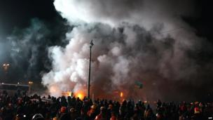 Clouds of smoke rise above Ukrainian protesters clashing with riot police during an opposition rally in the centre of the capital, Kiev, in a show of defiance against strict new curbs on protests