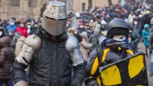 Protesters clad in improvised protective gear prepare for a clash with police in central Kiev, Ukraine, Monday, Jan. 20, 2014