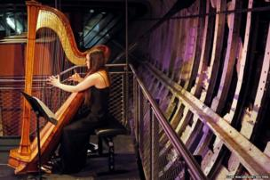 Harpist Glenda Allaway performs during a press launch of the Michael Edwards Studio Theatre in the former cargo hold of the Cutty Sark at Greenwich in London
