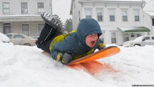 A boy on a sledge