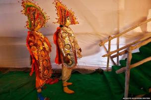 Artists wait to perform during a press preview for the Republic Day parade in New Delhi