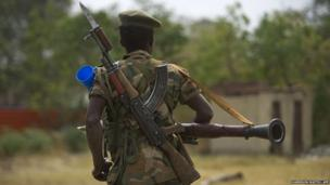 South Sudanese government army soldier patrols in Malakal