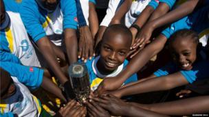 School children hold the Queen's baton in Karura Forest in Nairobi, Kenya.