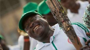 Dr Ro Oladipo the President General of the Nigerian Sports Supports Union holds the Queen's baton during celebrations in Lagos, Nigeria.