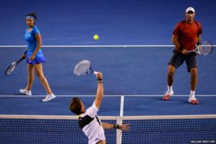 India's Sania Mirza and partner Romania's Horia Tecau await a return during their mixed doubles semi-final match against Australia's Jarmila Gajdosova and Mathew Ebden