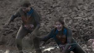 Tough Guy competitors in mud