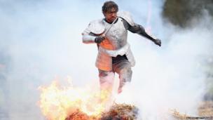 Tough Guy competitor runs through fire