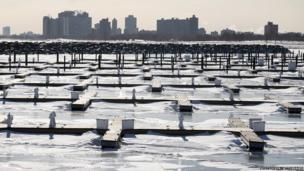 Ice surrounds the boat docks in the harbour at 31st Street Beach in Chicago, Illinois, as temperatures drop below zero on 27 January.