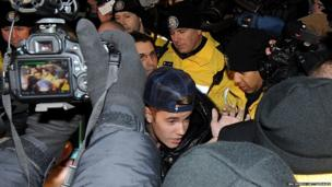 Justin Bieber appears at a police station