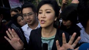 Thai Prime Minister Yingluck Shinawatra answers questions from the press after voting