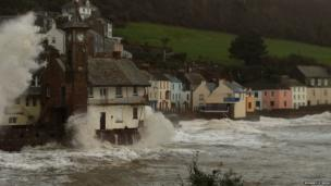 The clock tower in Kingsand is battered by waves caused by the stormy weather