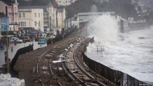 Waves break over the railway line at Dawlish, Devon