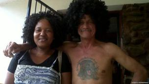Wig-wearing man together with his housekeeper in South Africa