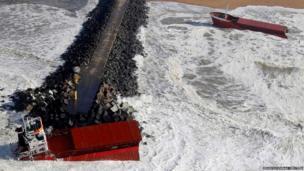 An empty Spanish cargo ship split in half on a breakwater near Bayonne on the Atlantic coast