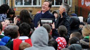 Prime Minister David Cameron and Gary Lineker (right) speak to children at St Bridget's Catholic primary school in Birmingham, as they visited the school to watch sporting activities