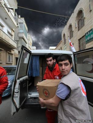 Aid workers collect delivery