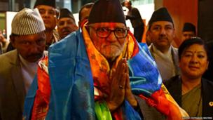 Newly elected Sushil Koirala greets the media