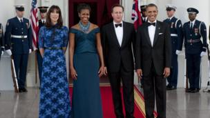 President Barack Obama and First Lady Michelle Obama pose with British Prime Minister David Cameron and his wife, Samantha Cameron, outside the White House on 14 March 2012
