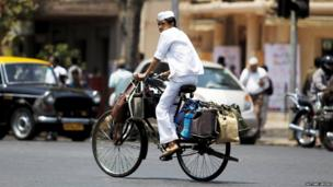 Dabbawala on a heavily laden bicycle