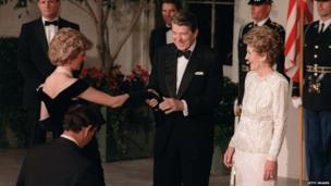 President Ronald Reagan shakes hands with Princess Diana as she and Prince Charles enter the White House for a state dinner on 9 November 1985