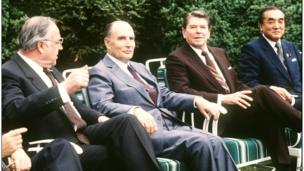 French President Francois Mitterrand (centre left) and US President Ronald Reagan (centre right) flanked by German Chancellor Helmut Kohl (left) and Japanese Premier Yasuhiro Nakasone (right) during the Summit of Leading Industrial Countries in Williamsburg, Virginia in May 1983