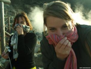 Two women covering their noses