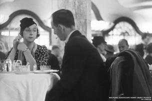 A couple enjoying tea in the Lyons Corner House at the junction of Oxford Street and Tottenham Court Road