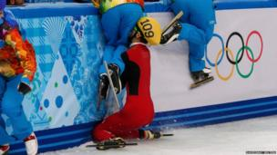 China's Kexin Fan crashes out into the barrier during the women's 500m short track speed skating semi final at the Sochi Winter Olympics
