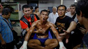 A fighter in his dressing room at the Lumpinee stadium in Bangkok