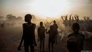 South Sudanese children from the Dinka ethnic group pose at cattle camp in the town of Yirol, in central South Sudan