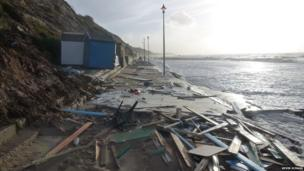Damaged beach huts and the aftermath of the storms on sea front at Fishermans Walk in Southborne on Sea, Dorset. Photo: Kevin Scragg