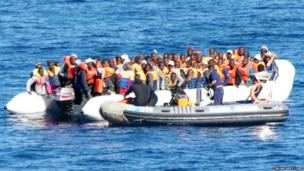 A photo taken on 16 February 2014 by the Italian Navy shows immigrants being rescued by the Italian Navy near the Italian island of Lampedusa