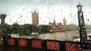 Rain on the window of a London bus