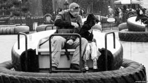 Man and girl on fair ride