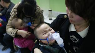 Children with respiratory illness receive treatment at a hospital in Beijing on 21 February 2014