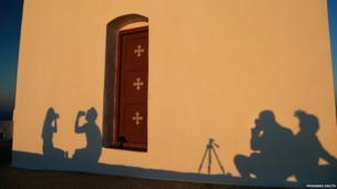 Shadows on a church wall