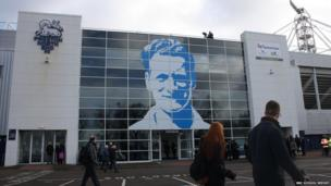 Sir Tom's face on the outside of Deepdale stadium