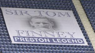 The flag in honour of Sir Tom on display inside the stadium