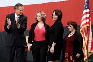 Ohio Governor John Kasich, from left, introduces Amanda Berry, Gina DeJesus and Michelle Knight during his State of the State address at the Performing Arts Center Monday in Medina, Ohio, 24 February 2014