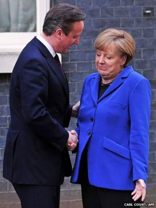 British Prime Minister David Cameron greets German Chancellor Angela Merkel outside 10 Downing Street in London