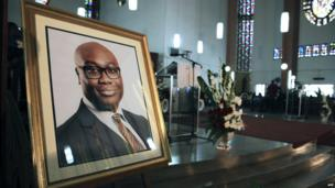 A portrait of BBC presenter Komla Dumor is set during his funeral on February 21, 2014, in Accra, Ghana