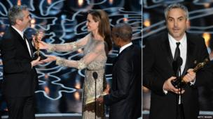 Director Alfonso Cuaron accepts the best director Oscar from Angelina Jolie and Sidney Poitier