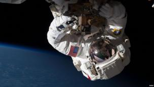 Flight Engineer Chris Cassidy repairing the station in orbit on Expedition 35.