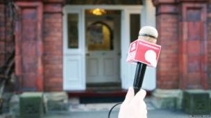 Microphone in front of school front door