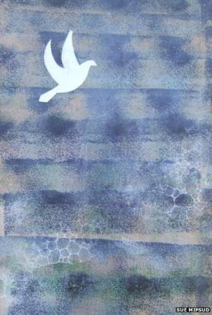 Ceramic image of dove against a blue background